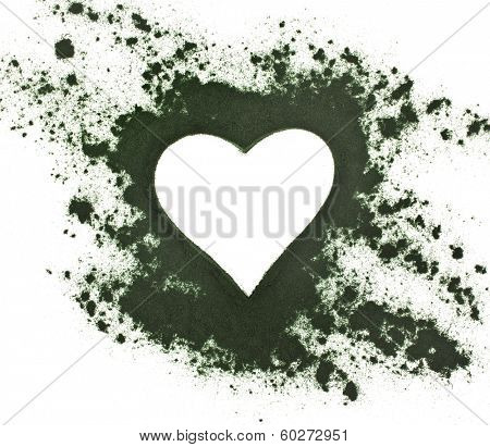Spirulina powder - algae, nutritional supplement,  shape heart surface top view  isolated on white background