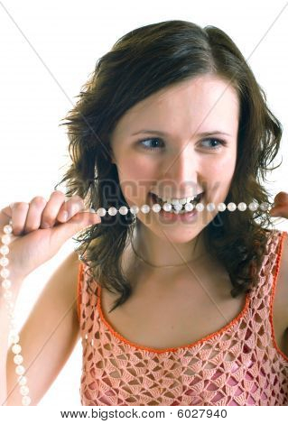 Girl Holds A Pearl Beads