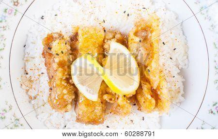 a bowl of lemon chicken