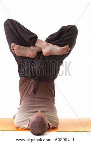 Image of flexible yogi posing in difficult pose