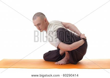 Shot of handsome middle aged yogi posing in studio