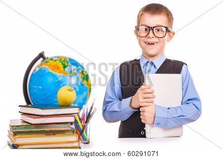schoolboy with books and laptop on a white