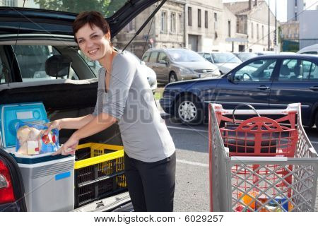 Woman Loading Car