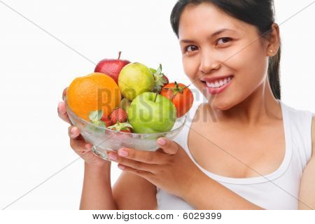 Asian Woman Holding Bowl Of Fruits