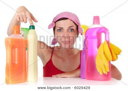Woman And Cleaning Supplies