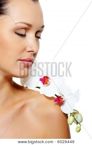 Beautiful Woman With A Flower On Her Shoulder