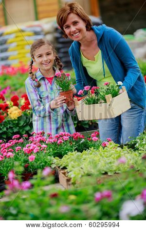 Planting, garden flowers - family shopping plants and flowers in garden center
