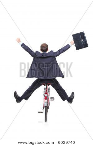 Happy young businessman on a bicycle