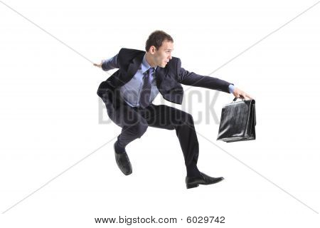 Young businessman with a briefcase jumping