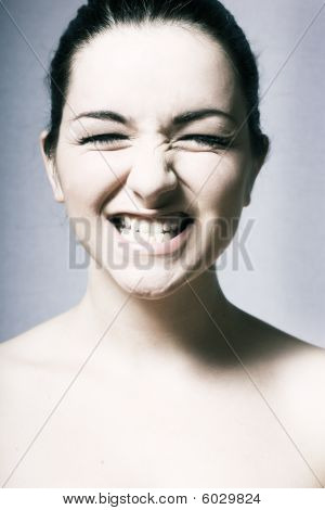 Woman Pulling A Massive Grin