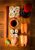 image of soy sauce  - Snack with traditional mixed sushi soy sauce and chopsticks on a wooden plate - JPG