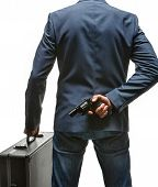 stock photo of pistol  - studio photography of criminal man with pistol and briefcase  - JPG