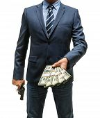 image of plunder  - studio photography of criminal man with money and gun  - JPG