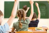 stock photo of classmates  - School children in classroom at lesson in school - JPG