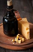 foto of vinegar  - Delicious parmesan cheese and bottle of old balsamic vinegar - JPG