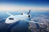 stock photo of jet  - Private jet plane in the blue sky - JPG