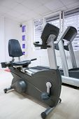 elliptical cross trainer, stationary bicycle at fitness gym