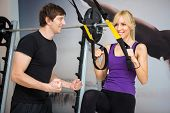 stock photo of personal assistant  - Personal trainer assist woman exercising on at gym - JPG