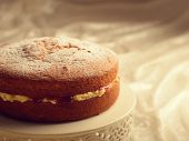 stock photo of sponge-cake  - Freshly baked Victoria sponge cake filled with jam and buttercream - JPG