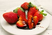 image of vinegar  - strawberries with balsamic vinegar over ceramic plate - JPG
