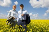 stock photo of business-partner  - Portrait of confident business partners looking forward against blue sky - JPG