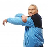 pic of cardio exercise  - Senior man in training suit doing warm - JPG