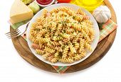 stock photo of pesto sauce  - pasta fusilli in plate isolated on white background - JPG