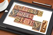 what is your story question in vintage wooden letterpress printing blocks on a digital tablet with a