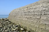 picture of cornerstone  - old concrete blocks against a blue sky - JPG
