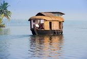stock photo of houseboats  - landscape with houseboat in kerala backwaters India - JPG