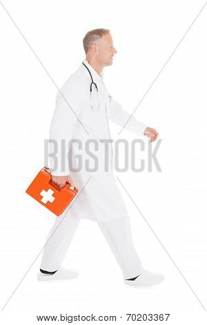 Doctor Walking With First Aid Kit Box