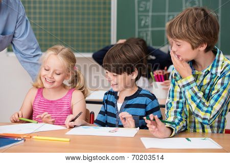 Young Children Laughing At A Classmate