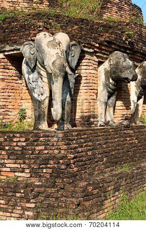 Elephants Statues On Ruins Of Buddhist Temple.