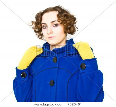 Curly-haired Woman In Coat
