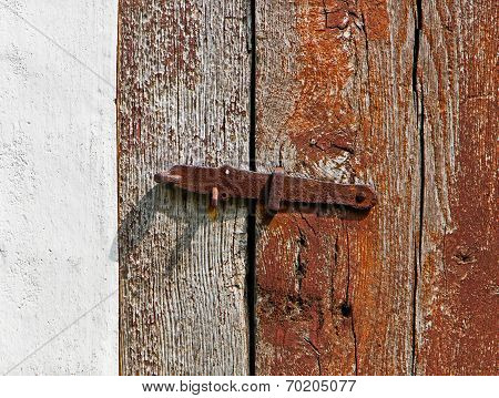 Iron Latch On A Wooden Door