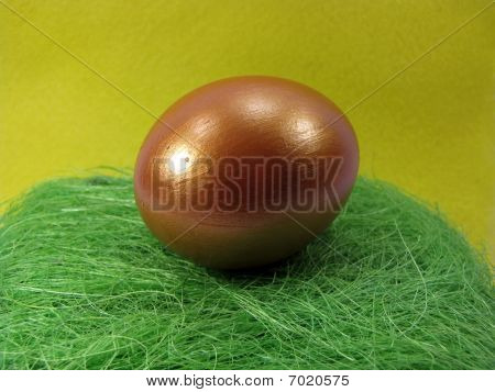 Golden Egg on green nest