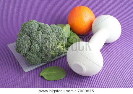 Fruit And Vegetables With Exercise Equipment