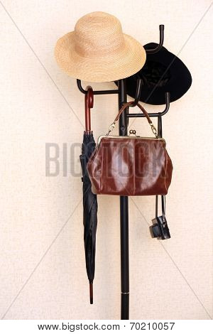 Coat rack with female accessories