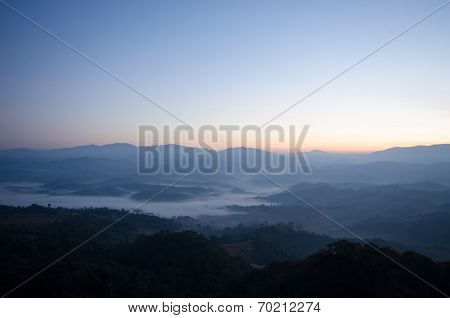 Mountain with mist and sun rise