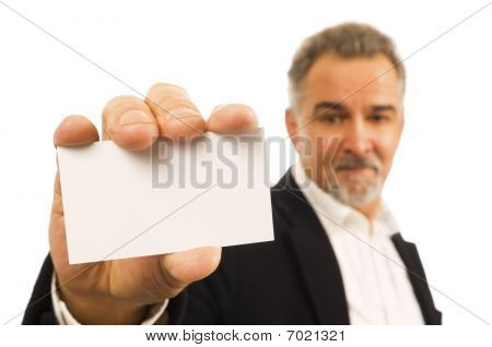 Mature Businessman Holds A Blank Business Card In His Hand