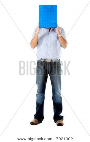 Man Covering His Face With A Shopping Bag