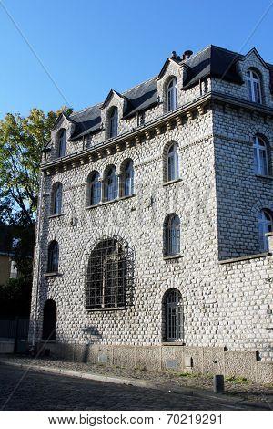 PARIS - NOVEMBER 04: Old house in Montmarte alley in Paris November 04, 2012 in Paris, France.