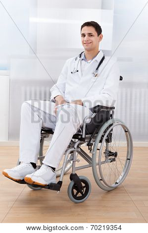 Handicapped Doctor Sitting On Wheel Chair In Hospital
