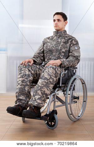 Patriotic Soldier Sitting On Wheel Chair
