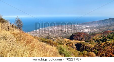 scenic landscape of mountain valley (dale) with blue sky, white clouds and colorful houses (Tenerife, Canary islands, Spain)