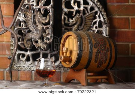 Glass Of Brandy Near A Fireplace