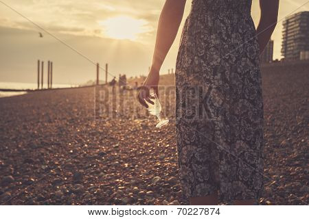 Young Woman On The Beach With Glass Of Wine