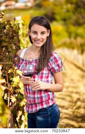 beautiful young woman with glass of wine