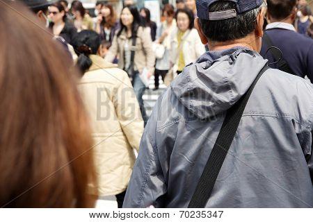 Pedestrians cross at Shibuya Crossing