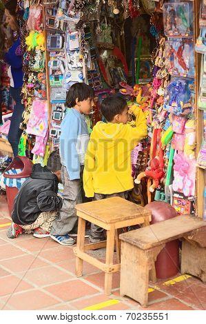Children at Toy Stand in Banos, Ecuador